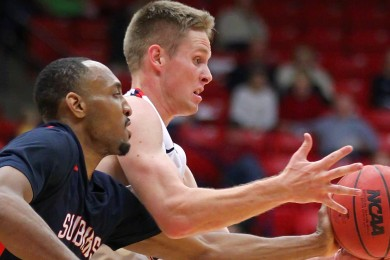 Zac Hunter grabs a loose ball for the Red Storm, Dixie State University vs. Fresno Pacific University, Mens Basketball, St. George, Utah, Dec. 13, 2014 | Photo by Robert Hoppie, ASPpix.com, St. George News
