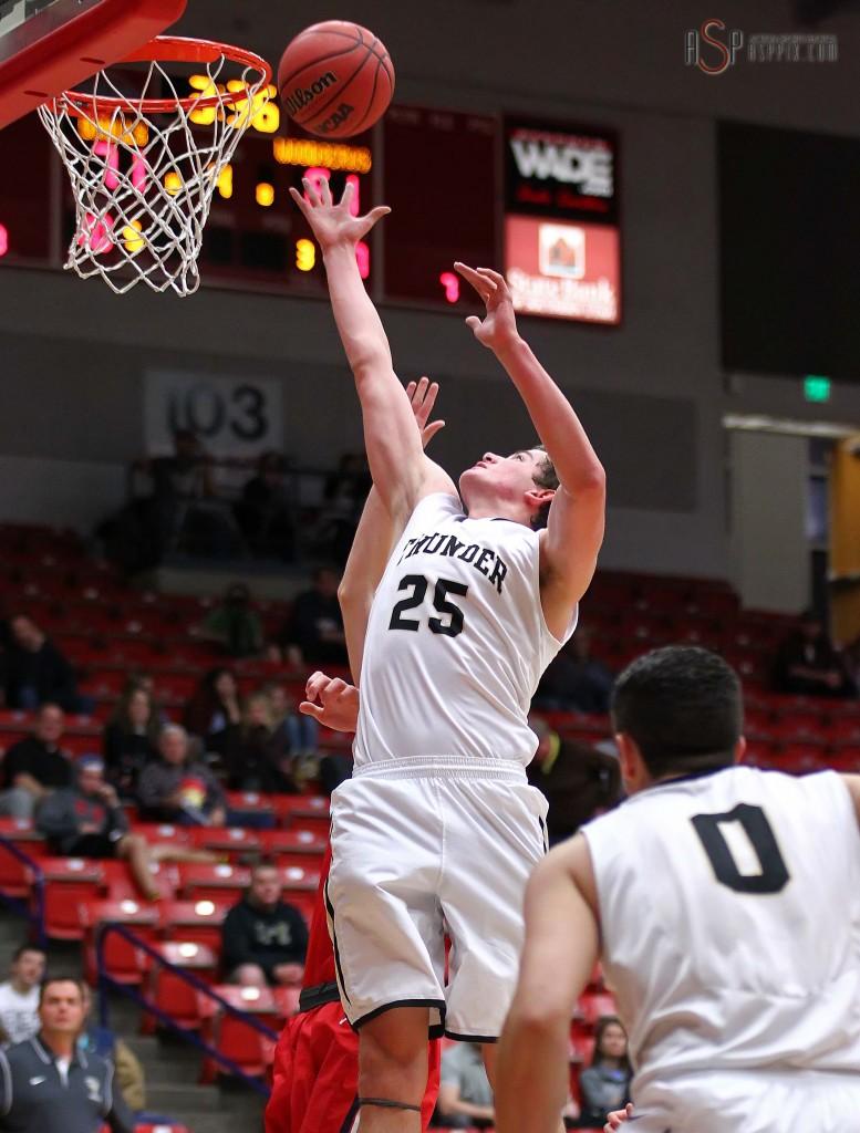 Austin Adams grabs a rebound for the Thunder, Desert Hills vs. Woods Cross, Boys Basketball, St. George, Utah, Dec. 19, 2014 | Photo by Robert Hoppie, ASPpix.com, St. George News