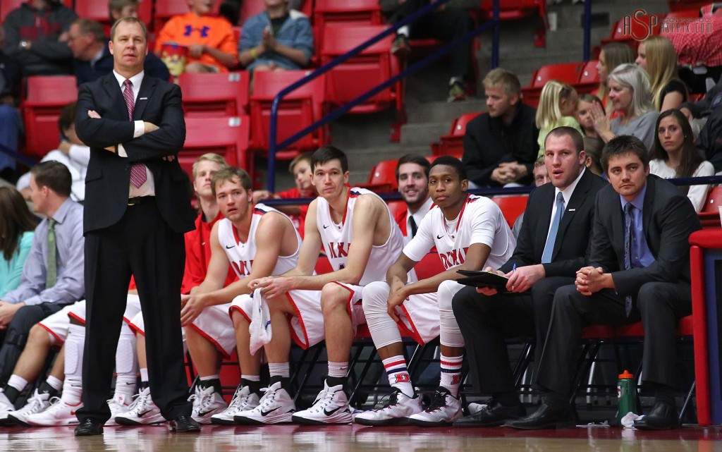 Red Storm Head Coach Jon Judkins stands in front of the Dixie State bench, Dixie State University vs. Holy Names University Mens Basketball, St. George, Utah, Dec. 20, 2014 | Photo by Robert Hoppie, ASPpix.com, St. George News