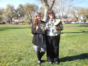 Jackie Campbell (left)and her mom, Jennie Campbell, show a picture of Lt. William Clinton Campbell and the hat he wore the day of Pearl Harbor at the Pearl Harbor Ceremony held at the Vernon Worthen Park, 300 S. 400 E. in St. George, Utah, Dec. 7, 2014 | Photo by Aspen Stoddard, St. George News
