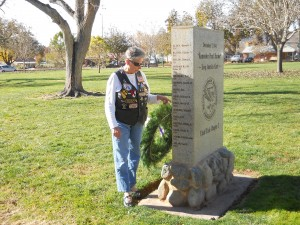 Linda High-Spiry points out her late husband's name on the Pearl Harbor monument at the Vernon Worthen Park, 300 S. 400 E. in St. George, Utah, Dec. 7, 2014   Photo by Aspen Stoddard, St. George News
