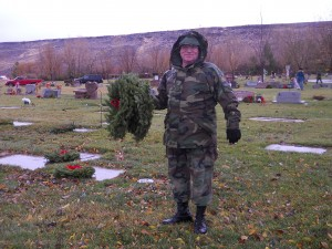 The dark sky sets a somber tone to the Wreaths Across America ceremony Saturday morning at the Tonaquint Cemetery located at 1851 South Dixie Drive in St. George, Utah, Dec. 13, 2014 | Photo by Aspen Stoddard, St. George News