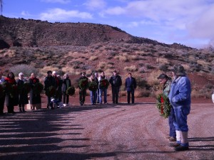 "Clarence ""Beans"" John stands in front of guests, holds a wreath and talks about the importance of honoring fallen veterans at the Shivwits Cemetery, on the Shivwits Indian Reservation, Utah, Dec. 13, 2014 