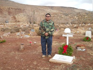 Glenn Rogers, councilman for the Shivwits Band of Paiutes, stands beside the grave of his uncle Crawford Snow at the Shivwits Cemetery, on the Shivwits Indian Reservation, Utah, Dec. 13, 2014   Photo by Aspen Stoddard, St. George News