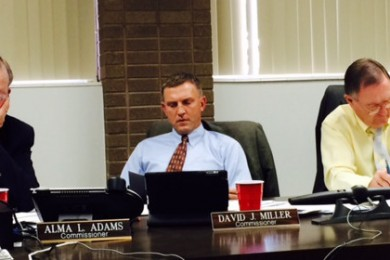 Iron County Commissioners Alma Adams (left), David Miller (center), and Dale Binkerhoff (right) read an outline of the proposal submitted by Classic Lifeguard Air Medical, Parowan, Utah, Dec. 8, 2014 | Photo by Devan Chavez, St. George News