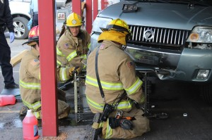 Emergency responders work to remove a shopping cart stuck under an SUV at IFA Country Store, St. George, Utah, Dec. 24, 2014 | Photo by Devan Chavez, St. George News