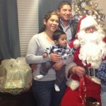 The Hernandez family pose for a picture with Santa Claus who brought them presents as part of the KONY Coins for Kids and USMC Toys for Tots program, St. George, Utah, Dec. 19, 2014 | Photo by Holly Coombs, St. George News
