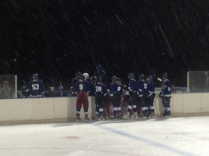 The Southern Utah Independent Yetis huddle before their first home game, Cedar City, Utah, Dec. 12, 2014 | Photo by, Holly Coombs