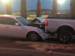 An Infiniti hits into a Ford Ranger during a three-car collision on 100 E. and 700 South, St. George, Utah, Dec. 1, 2014 | Photo by Holly Coombs, St. George News