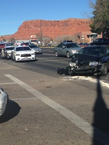 A Honda passenger car sits in the middle of an intersection after its involvement in a two-vehicle collision, St. George, Utah, Dec. 23, 2014 | Photo by Holly Coombs, St. George News