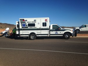 Gold Cross Ambulance responders prepare to transport a woman to the hospital following a single-car collision, St. George, Utah, Dec. 23, 2014 | Photo by Holly Coombs, St. George News
