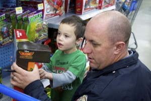Washington County youth chosen from KONY Coins for Kids were able to shop eat breakfast and shop with local law enforcement at Shop with a Cop, Hurricane, Utah, Dec. 13, 2014 | Photo by Samantha Tommer, St. George News