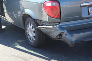 The damage to the back end of a Chrysler Town & Country following an accident at the intersection of 1400 West and Snow Canyon Parkway, St. George, Utah | Photo by Devan Chavez, St. George News
