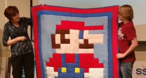 A Mario Brothers-themed quilt is auctioned off at Friday's Dixie Techs meeting, Dec. 5, 2014 | Photo by Julie Applegate, St. George News