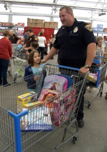 "Iron County ""Shop with a Cop"" helped provide nearly 100 children with Christmas presents, Cedar City, Utah, Dec. 13, 2014 