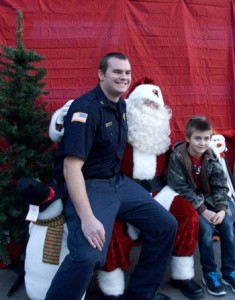 "Iron County ""Shop with a Cop""  volunteers stop to take a picture with the children they shopped with and Santa Claus, Cedar City, Utah, Dec. 13, 2014 