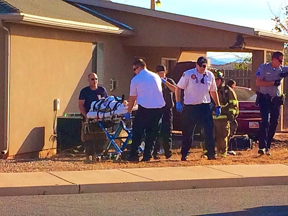 A woman was transported to the hospital after experiencing a medical episode and crashing her car through a home located at 279 N. Scenic Drive West, Washington, Utah, Dec. 7, 2014 | Photo by Kimberly Scott, St. George News
