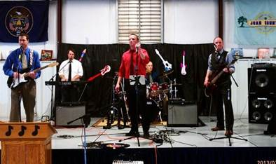 Lt. Gov. Spencer Cox on far right playing in brother's rock band, location and date not specified | Photo courtesy of Scott Hirschi, St. George News