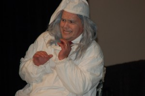 """Roy Eckman as Scrooge gets visited by Marley's Ghost during a scene of """"Scrooge"""" performed nightly at the Dickens' Festival held at the Dixie Convention Center, St. George, Utah, Dec. 3, 2014 