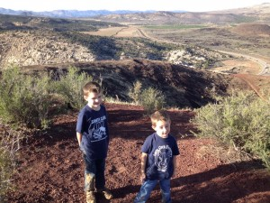 L-R, Hunter Reina and Conor Reina smile at the top of the cinder cone with the crater in the background, St. George, Utah, November, 2014   Photo by Hollie Reina, St. George News