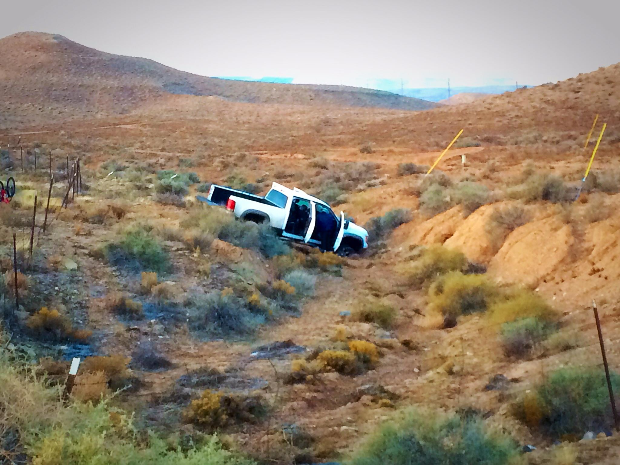 Truck ditched in a ditch by four occupants who fled police on foot near Utah's southern Port of Entry of Interstate 15 southbound, St. George, Utah, Dec. 9, 2014 | Photo by Kimberly Scott, St. George News