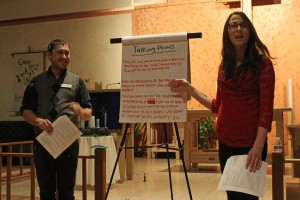 """Preston Hilburn and Tara Owen go over some """"Talking Points"""" with attendees, Dec. 2, 2014 