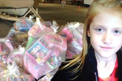 Mckinlee Albrecht, 8, helped deliver toys to children for the Toys for Tots program, St. George, Utah, Dec. 20, 2014 |Photo by Holly Coombs, St. George News