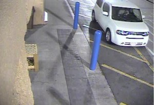 A white Nissan Cube is identified as the suspect vehicle at the entrance of Wal-Mart, Cedar City, Utah, Dec. 9, 2014  Photo courtesy of Cedar City Police Department, for St. George News