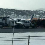 A 60,000 pound UDOT snowplow truck flipped over on Interstate 15 near southbound Exit 120, Manderfield, Utah, Dec. 24, 2014 | Photo by Corbin Wade, KCSG Television and St. George News