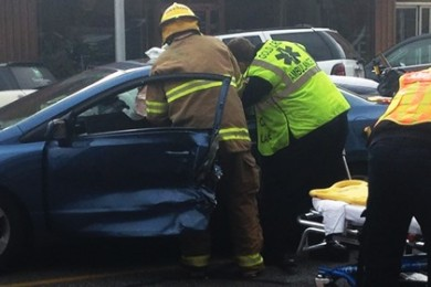 St. George firefighters  extricate a woman from her car at the scene of an accident on Tabernacle Street, St. George, Utah, Dec. 17, 2014   Photo by Holly Coombs, St. George News