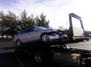 The Toyota Avalon is towed after a collision that occurred in the parking lot near 700 West Telegraph St. in Washington City, Utah, Dec. 21, 2014 | Photo by Aspen Stoddard, St. George News