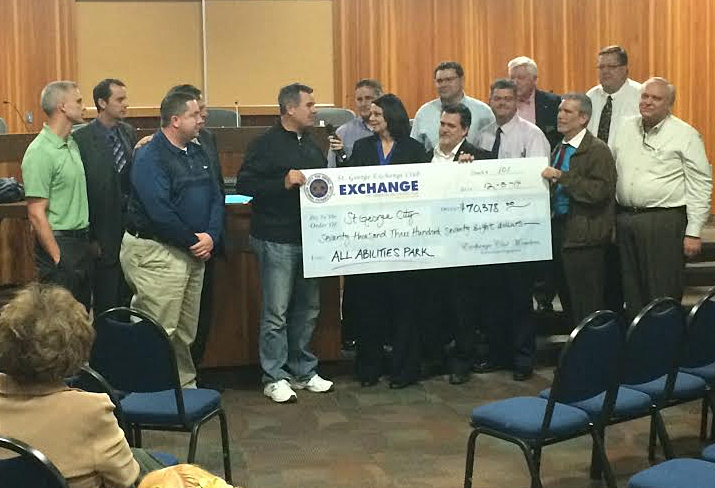 Shonie Christensen presenting a $70,328 check to Mayor Jon Pike, St. George, Utah, Dec. 3, 2014 | Photo by Brett Brostrom, St. George News