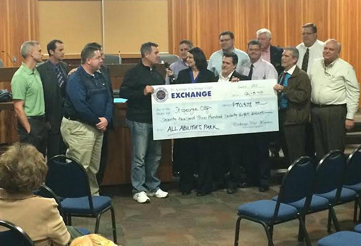Shonie Christensen presenting a $70,328 check to Mayor Jon Pike, St. George, Utah, Dec. 3, 2014 | Photo by Brett Brostrom, St. George News