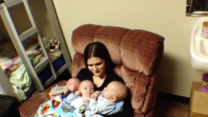 New mom Khylie Saxton holds her new identical triplets at SwitchPoint Community Resource Center, St. George, Utah, Jan. 27, 2015 | Photo by Cami Cox Jim, St. George News