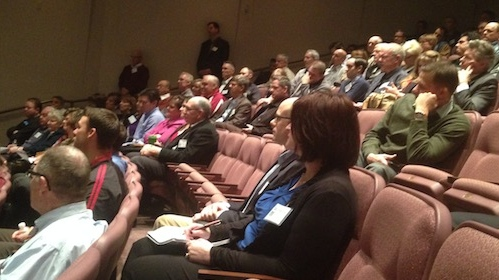 """Audience members listen to Lt. Gov. speak at the 2015 """"What's Up Down South"""" economic summit, St. George, Utah, Jan. 15, 2015 