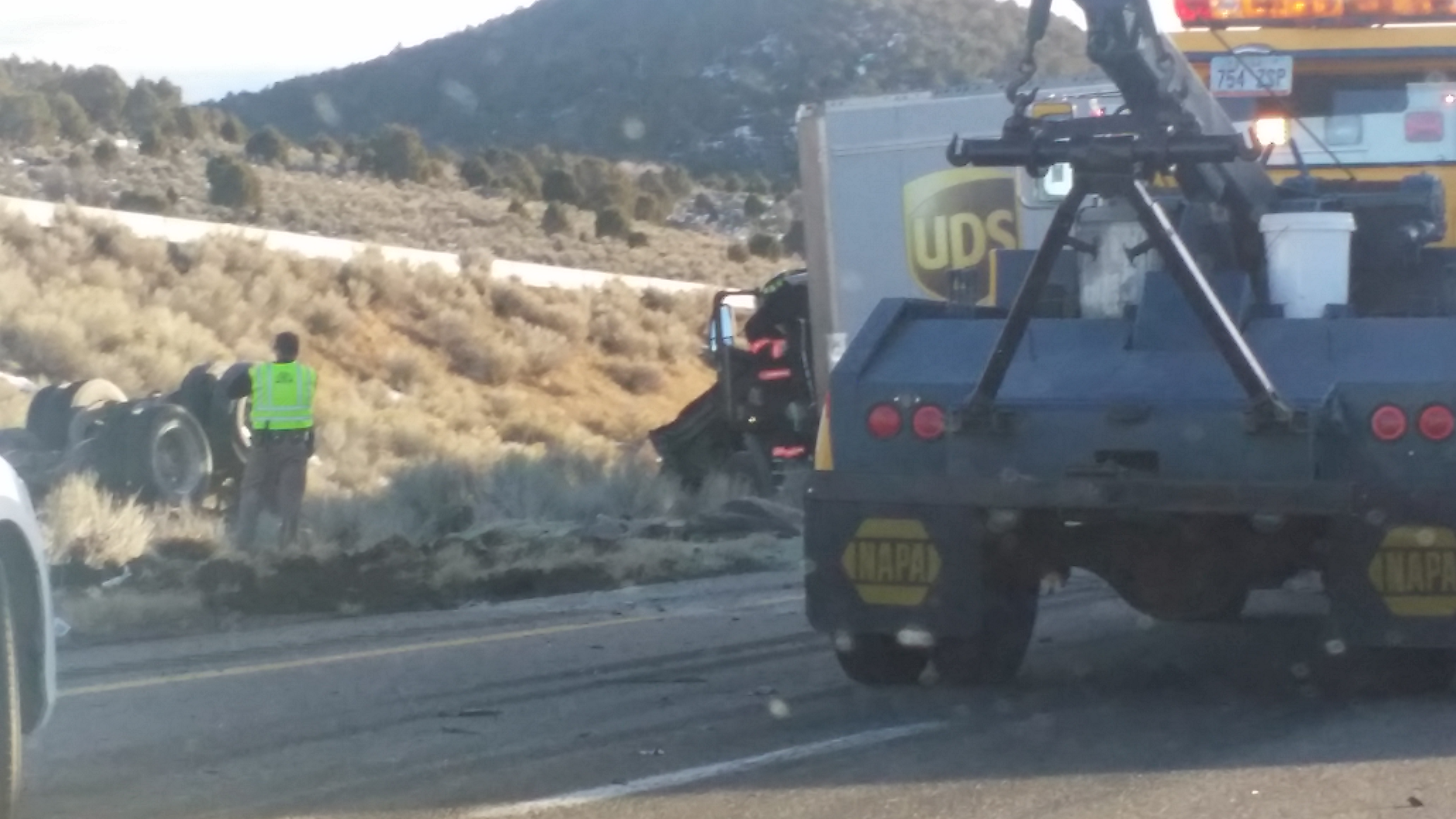 Two truck drivers were transported to Beaver Valley Hospital following a rollover in Interstate 15, near Beaver, Utah, Jan. 28, 2015 | Photo Courtesy of Jim and Kelly McCune, St. George News