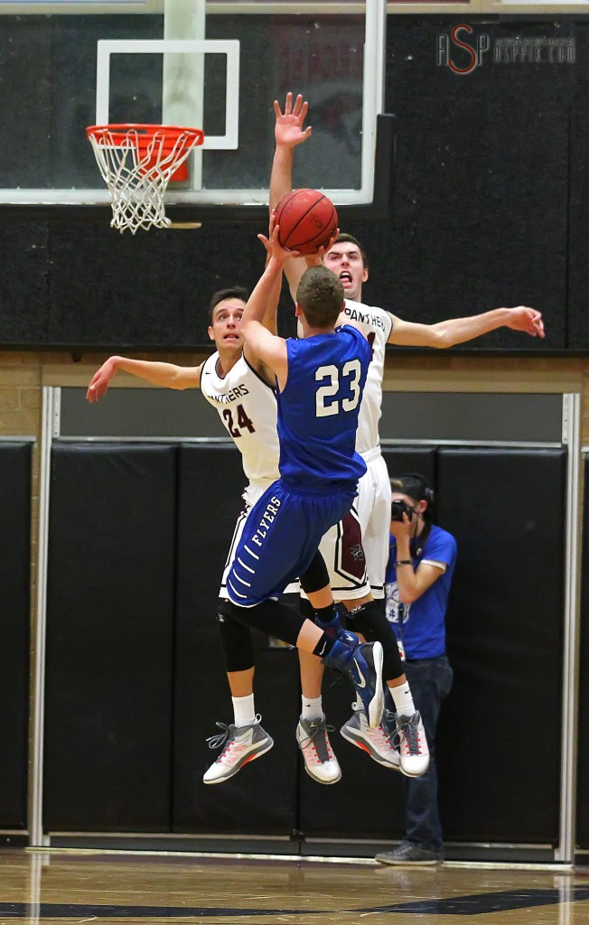 Flyer F Jake Hawes (23) puts up the game winning shot over Jed Newby (24) and Kody Wilstead, Dixie vs. Pine View, Boys Basketball, St. George, Utah, Jan. 7, 2015 | Photo by Robert Hoppie, ASPpix.com, St. George News