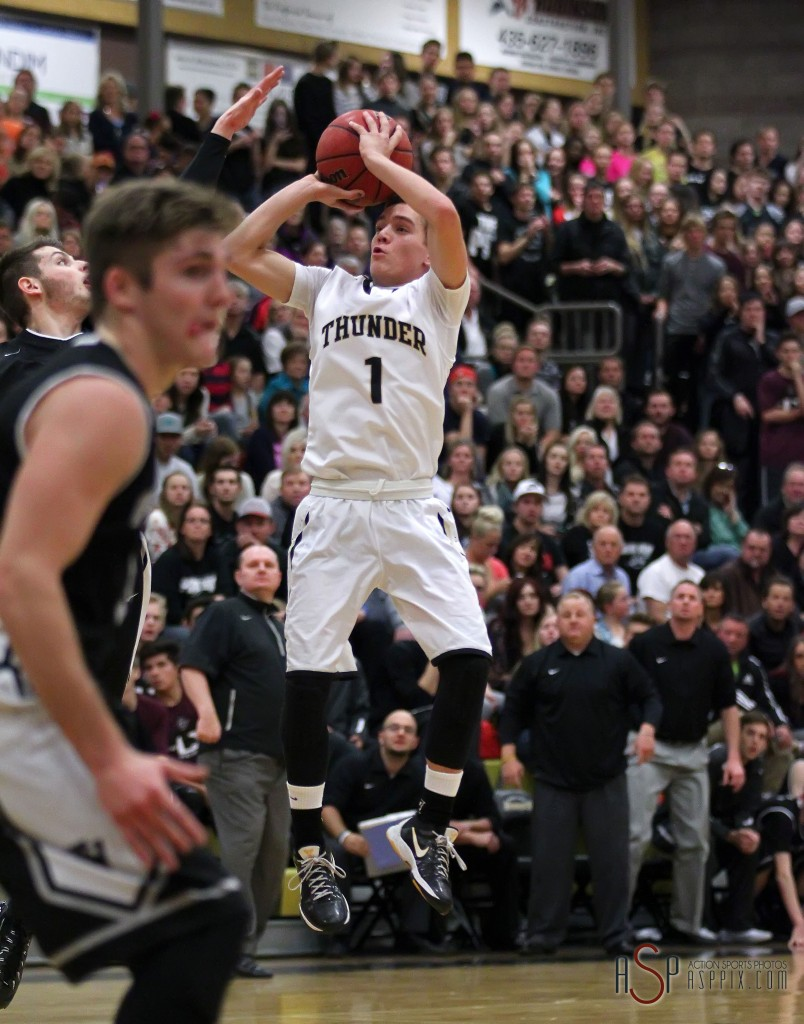 Logan Hokanson (1) with a double clutch jumper late in the contest, Desert Hills vs. Pine View, Boys Basketball, St. George, Utah, Jan. 9, 2015 | Photo by Robert Hoppie, ASPpix.com, St. George News
