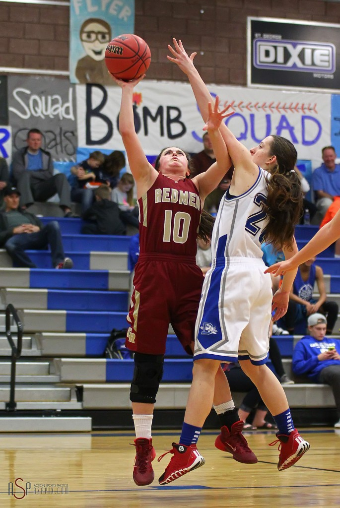 Amanda Manley (10) fires up a shot for the Lady Redmen, Cedar vs. Dixie, Girls Basketball,  St. George, Utah, Jan. 13, 2015 | Photo by Robert Hoppie, ASPpix.com, St. George News