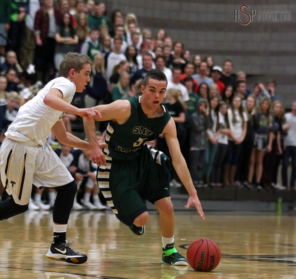 Jacob Frei dribbles the ball up court with Logan Hokanson defending, Snow Canyon vs. Desert Hills, Boys Basketball,  St. George, Utah, Jan. 14, 2015 | Photo by Robert Hoppie, ASPpix.com, St. George News