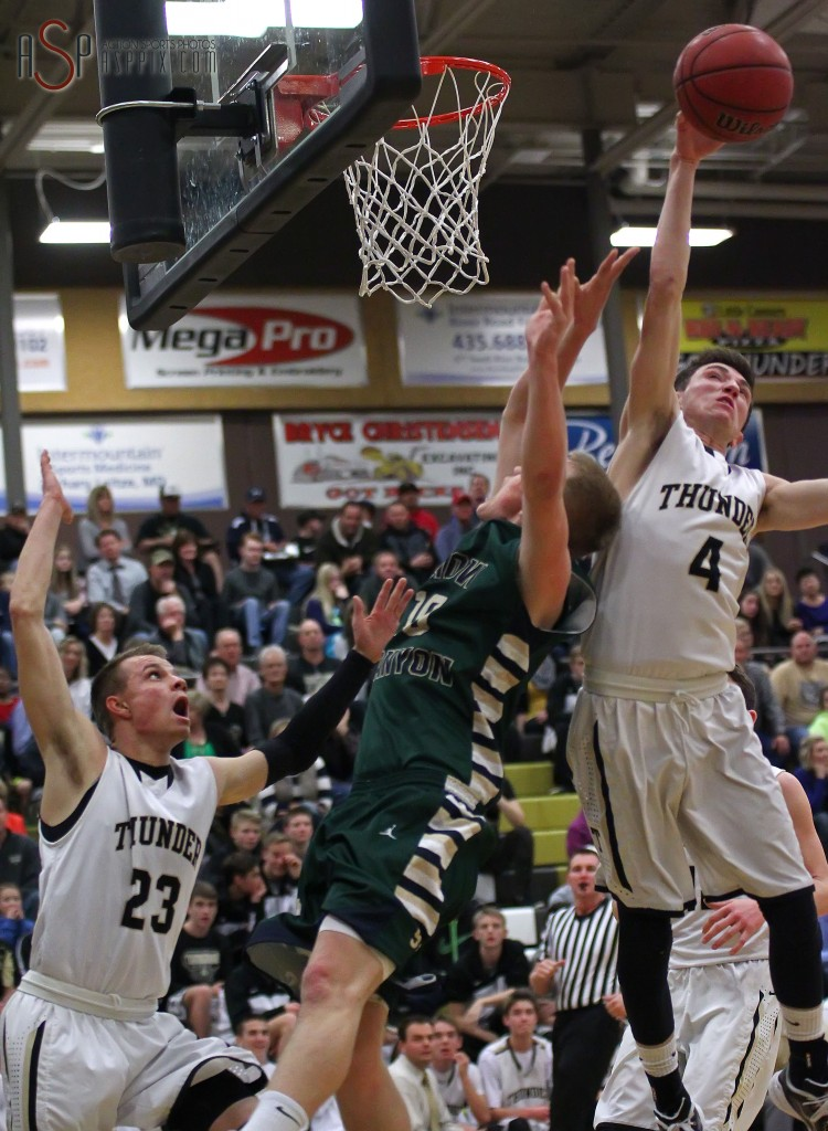 Thunder G Logan Forsyth (4) comes up with a big block on Brock Staheli's shot in the paint, Snow Canyon vs. Desert Hills, Boys Basketball,  St. George, Utah, Jan. 14, 2015 | Photo by Robert Hoppie, ASPpix.com, St. George News