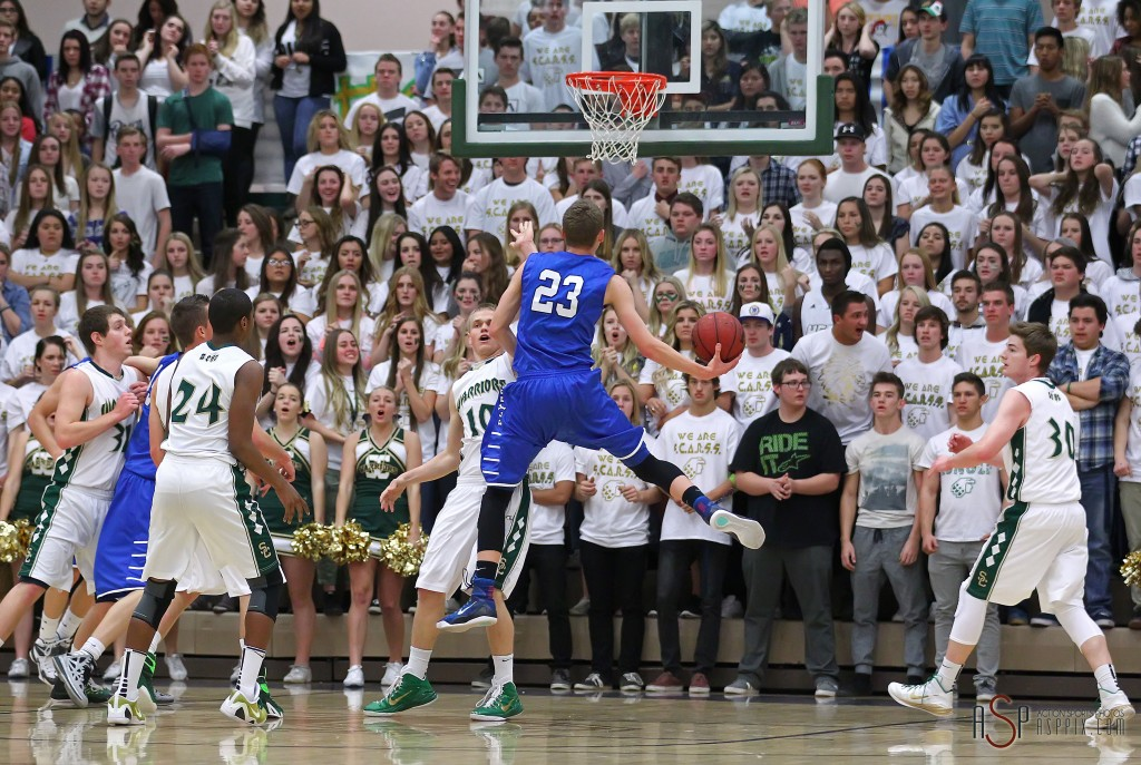 Dixie F Jake Hawes (23) floats to the hoop in front of the Snow Canyon student section, Dixie vs. Snow Canyon, Boys Basketball,  St. George, Utah, Jan. 16, 2015 | Photo by Robert Hoppie, ASPpix.com, St. George News