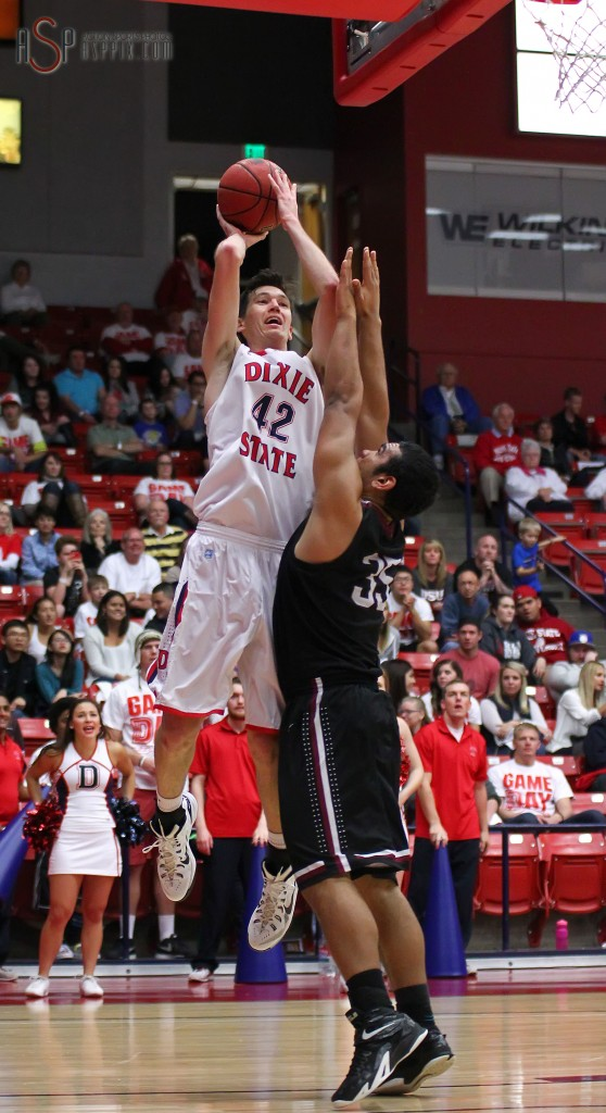 Zach Robbins (42) with a shot over a Cougar defender, Dixie State University vs. Azusa Pacific University, Mens Basketball,  St. George, Utah, Jan. 17, 2015 | Photo by Robert Hoppie, ASPpix.com, St. George News