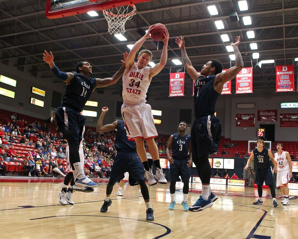 Zac Hunter (34) grabs a rebound for the Red Storm, Dixie State University vs. California Baptist University, Mens Basketball,  St. George, Utah, Jan. 19, 2015 | Photo by Robert Hoppie, ASPpix.com, St. George News