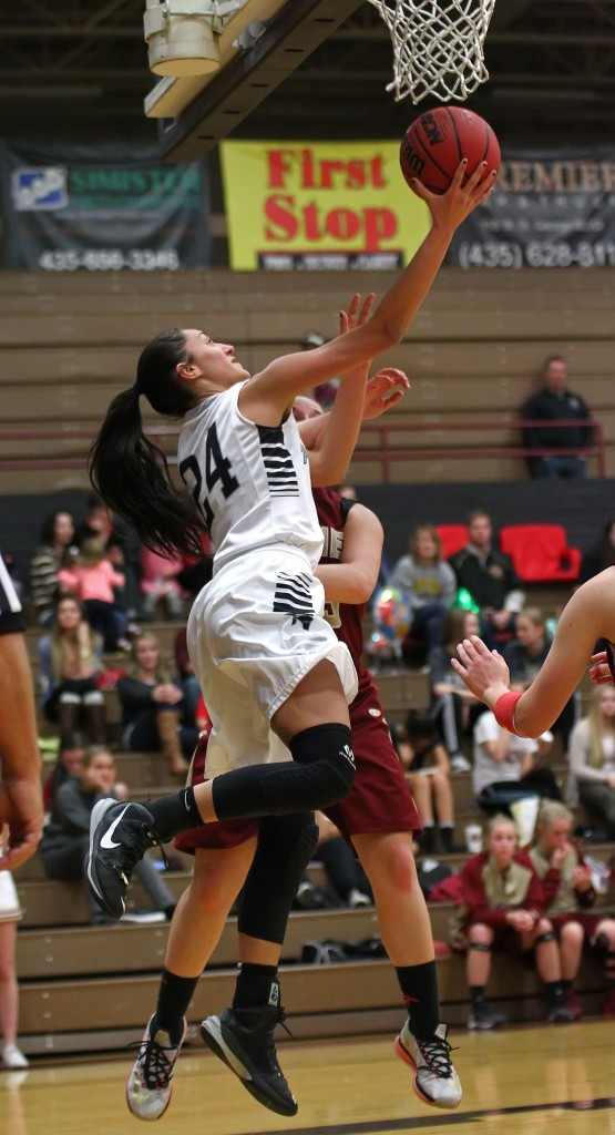 Pine View's Tayvia Ah'Quin (24) takes a reverse layup to the hoop for a score, Cedar vs. Pine View Girls Basketball,  St. George, Utah, Jan. 20, 2015 | Photo by Robert Hoppie, ASPpix.com, St. George News