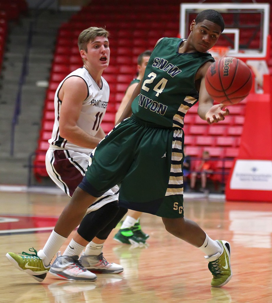 TJ Taimi (24) tries to save a ball from going out of bounds for the Warriors, Snow Canyon vs. Pine View, Boys Basketball,  St. George, Utah, Jan. 23, 2015 | Photo by Robert Hoppie, ASPpix.com, St. George News