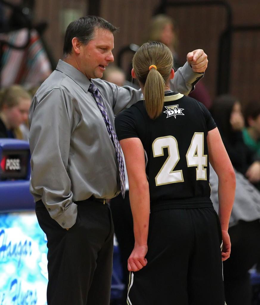 Thunder Interim Head Coach Ron Denos discusses strategy with Ashley Beckstrand (24), Desert Hills vs. Dixie, Girls Basketball, St. George, Utah, Jan. 27, 2015   Photo by Robert Hoppie, ASPpix.com, St. George News