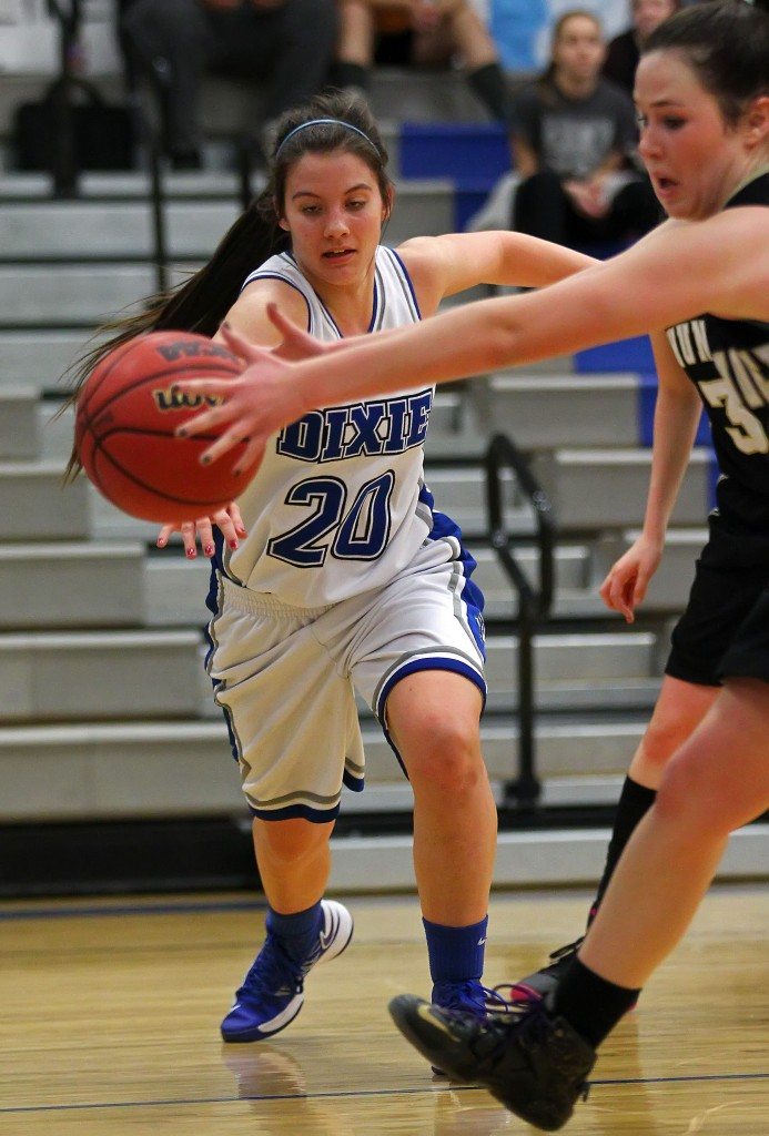 Taylor Whitson (20) and Ashlynne Drew reach for a loose ball, Desert Hills vs. Dixie, Girls Basketball, St. George, Utah, Jan. 27, 2015 | Photo by Robert Hoppie, ASPpix.com, St. George News