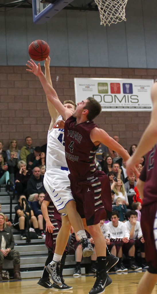 Pine View's Kody Wilstead (4) blocks the shot of Dixie's Richard Guymon, Pine View vs. Dixie, Boys Basketball, St. George, Utah, Jan. 30, 2015 | Photo by Robert Hoppie, ASPpix.com, St. George News