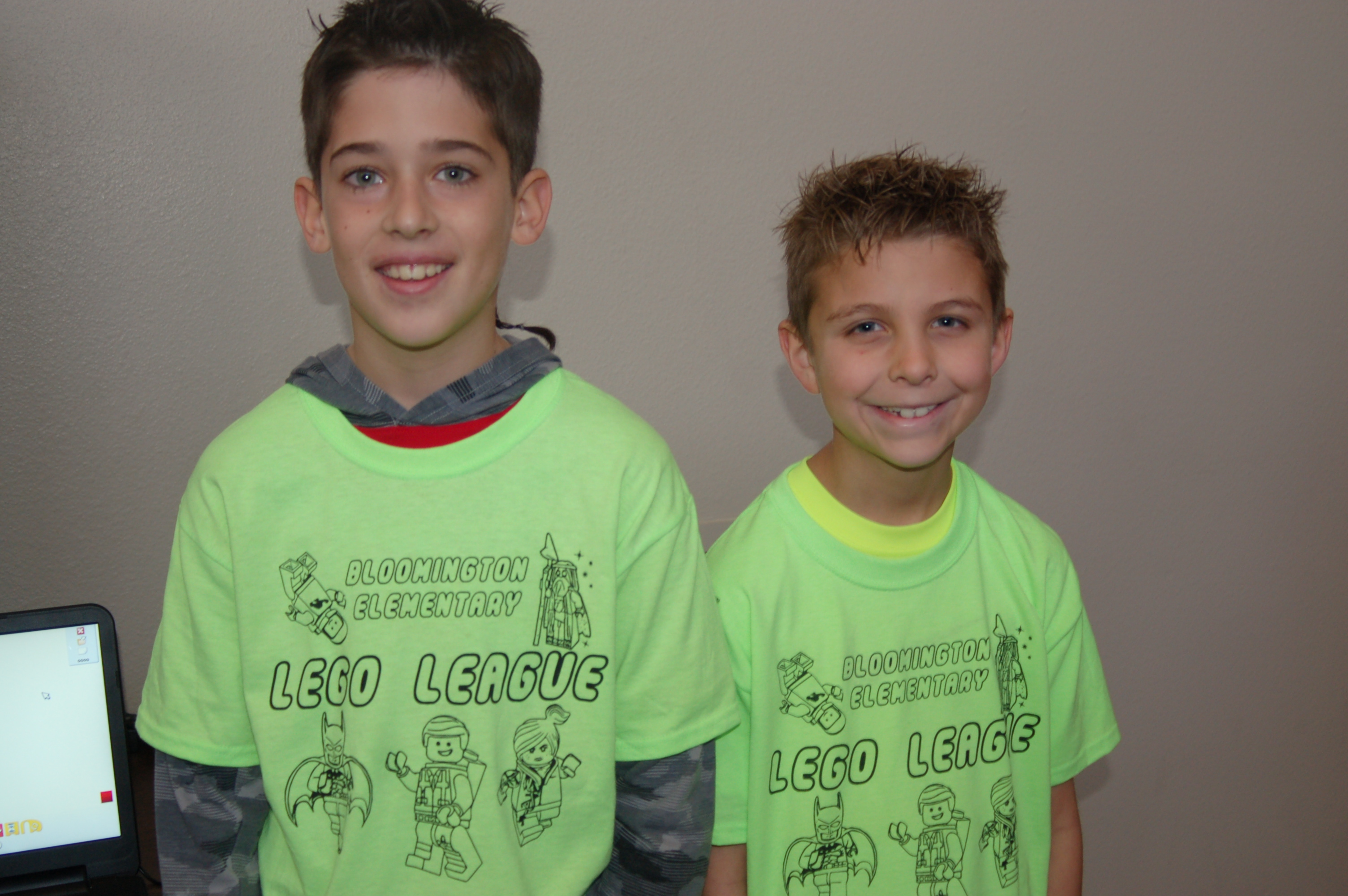 From left, Logan Evans and Bode Hafen smile for a photo and explain their project at the Lego robotics competition, St. George, Utah, Jan. 10, 2015 | Photo by Hollie Reina, St. George News